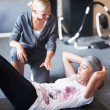 Royalty-Free Stock Photo: She really is an awesome personal trainer