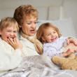 Her grandkids make her so happy - Stock Photo