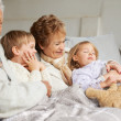 They love spending time with their grandparents - Stock Photo