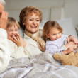 Quality time with granny and grandpa - Stock Photo