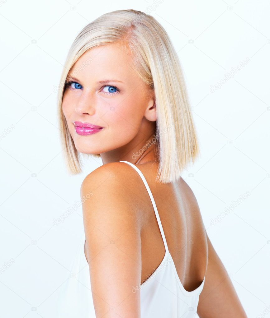 Closeup of a lovely young girl against a white background — Stock Photo #17008737