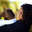 Feeling safe in the arms of her mother - Stock Photo