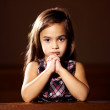 Looking for someone to answer her prayers - Stock Photo