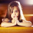 Saying a little prayer - Stock Photo