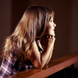 Praying strengthens her faith - Stock Photo
