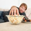 Snacking on the couch - Stock Photo