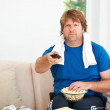 Countering all his hard working out with bad eating - Stock Photo