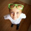 Blue eyes and green glasses - Stockfoto