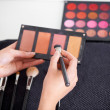 Professional makeup artist at work - Stock Photo