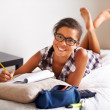 Doing homework in comfort - Stock Photo