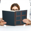 She always has her nose in a book - Stockfoto