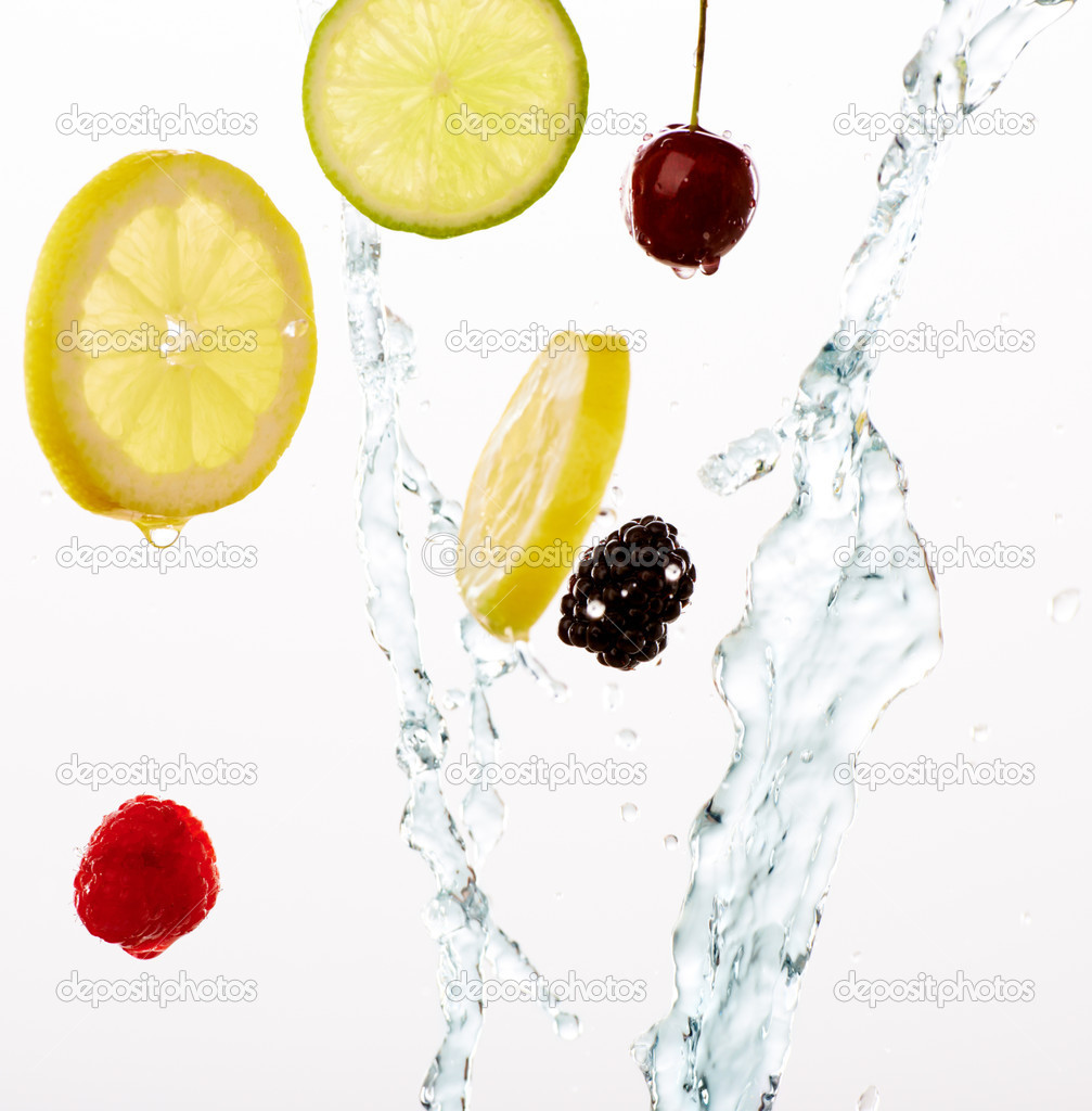 Studio shot of mixed fruit swirling through crystal clear water — Stock Photo #19084607