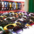 Sunglasses for sale at a market - Stock Photo