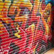 Graffiti in an urban area - Stock Photo