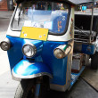 Tuk-tuks are part of Thai life - Stock Photo