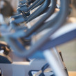 Exercise bikes on display - Stock Photo