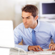 Dominating his workload - Focused employee - Stock Photo