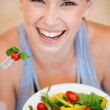 She enjoys healthy meal choices - Stock Photo