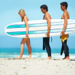 Strolling surfers - Stock Photo