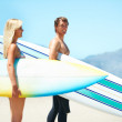 Confident and keen surfers - Stock Photo
