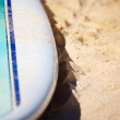 Surfboard on the sand - Stock Photo