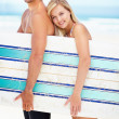 Surfing sweethearts - Stock Photo