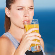 Enjoying a glass of fresh orange juice - Stock Photo