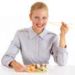 Sushi is a stable part pf her diet - Stock Photo
