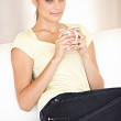 Relaxing with a cuppa... - Stock Photo