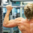Royalty-Free Stock Photo: Working on his back muscles
