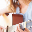 Skilled guitarist at work - Stock Photo