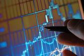 Analyzing Stock Market Chart — Stock Photo