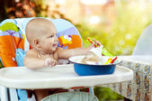 Baby in High Chair — Stock Photo