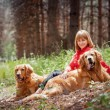 Portrait of a woman with her two dogs — Stock Photo #26647669