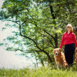 Portrait of a woman with her dog — Stockfoto