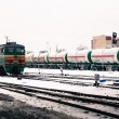 Freight train passing the  railway station — Stock Photo