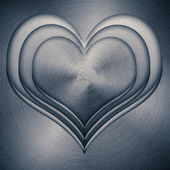 Heart, stamped into polished metal — ストック写真