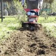 Stock Video: Garden tiller.