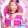 Little girl with Christmas gifts  — Stok fotoğraf