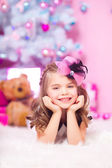 Little girl with Christmas gifts — Stock Photo