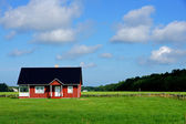 The house and field — Stock Photo