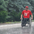 "Stock Photo: Ukraine, Crimea, Saki, 15-JUN-2013: International Marathon ""Scythicoast"", with limited mobility, spinal cord injury and paraplegiare participating in marathon 42 km"