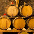 Stock Photo: An old wine cellar with oak barrels