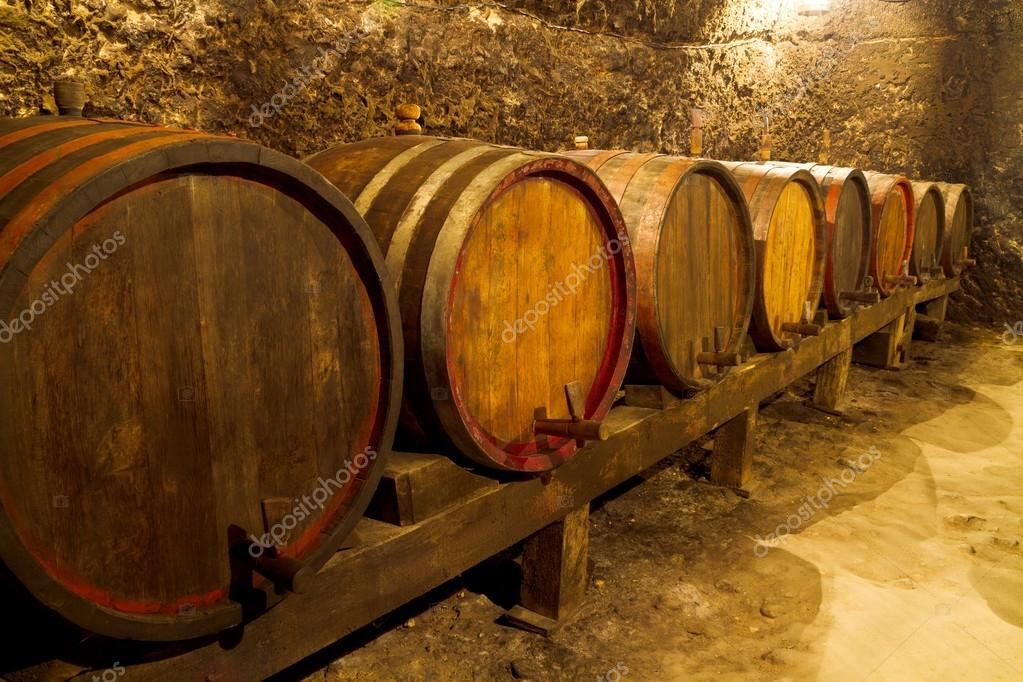 An old wine cellar with oak barrels  Stock Photo #12526008
