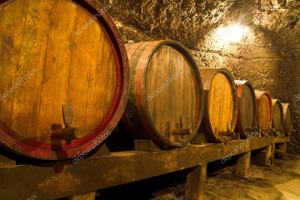 An old wine cellar with oak barrels  Stock Photo #12526036