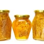 Honey jars isolated on white — Stock Photo #14861161