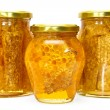 Honey jars isolated on white - Stock Photo