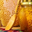 Jar of honey and honeycomb. Honey products — Photo
