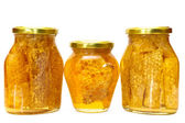 Honey jars isolated on white — Stock Photo