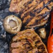 Meat steak on grill — Stock Photo